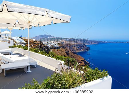 Chairs With Beautiful View To Relax in Santorini, Greece