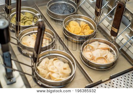 Machine for boiling or preparing dumplings in cafe kitchen