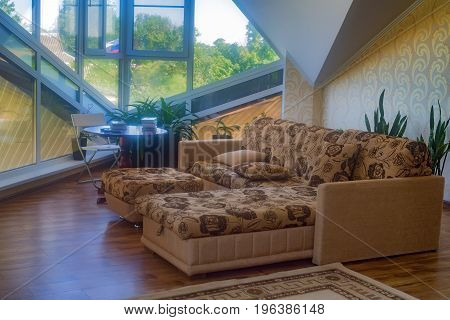 Luxury light interior of sitting room with large French windows