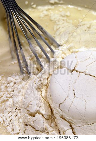 Whisk and mix for pancakes in a bowl