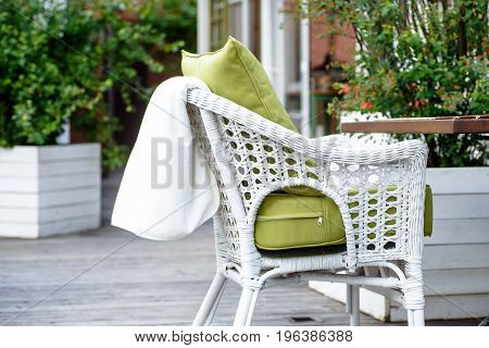 Plaid Lies On The Wicker Furniture From Rattan. Summer.