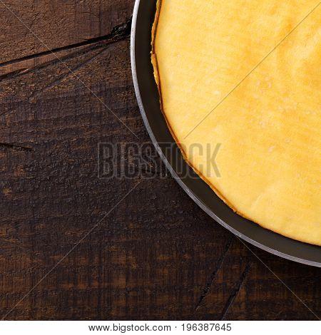 Cooking crepioca - pancake of cassava (tapioca) gluten-free on wooden background. Selective focus. Copy space