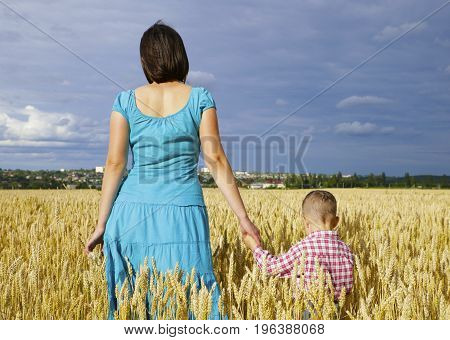 Young Mother With Her Son In The Field