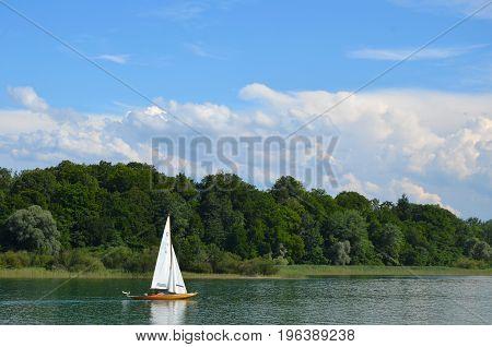 chiemsee bayern germany sailboat on the water