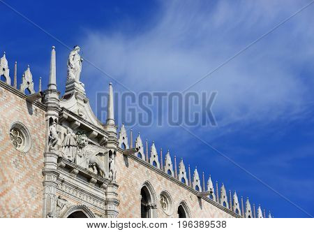 Doge Palace in Venice with gothic decoration and Saint Mark Lion (with clouds and copy space)
