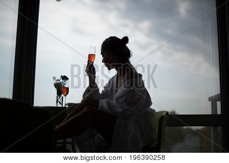 Beautiful Young Woman At Window. Sexy Girl Morning With Glass Of Wine At Window. Woman Near Window.