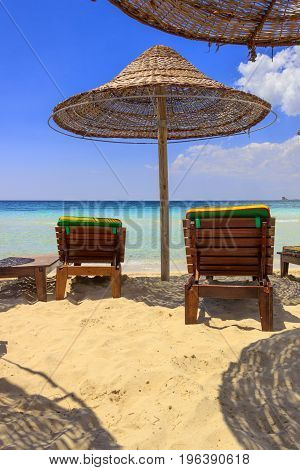 The most beautiful sand beaches of Apulia:Porto Cesareo marine,Salento coast.ITALY (Lecce).It's marine protected areas thanks to the high biological value of its very rich and varied marine community. Relax summer:shadow with lounge chairs and sun umbrell