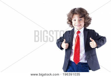 Cute Curly-haired Boy In A Red Tie, Looking At The Camera And Showing Hand Gestures