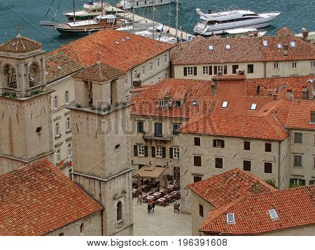 Aerial View of Kotor Old Town with the Historic Orange Tiled Roof Buildings and Bay of Kotor, Montenegro