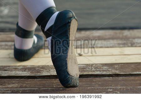 Blue ballet shoes with white socks in ballerina.