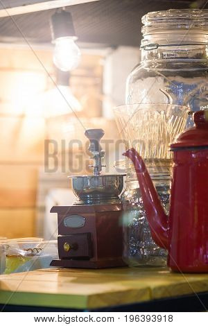Coffee Grinder And Pot Of Coffee On The Coffee Beans Background With Vintage Light Abstract concept.