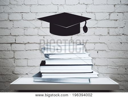 Abstract levitating mortarboard above shelf with book pile. Brick wall background. Education concept. 3D Rendering