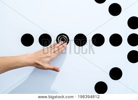Woman using hands with dot graphic on white wall. Business info graphic interface design concept.