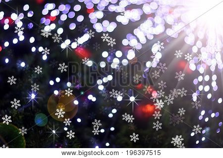 Defocused abstract light bokeh and flare christmas background