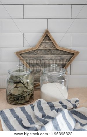 Glass jars with bulk products on a brick wall background