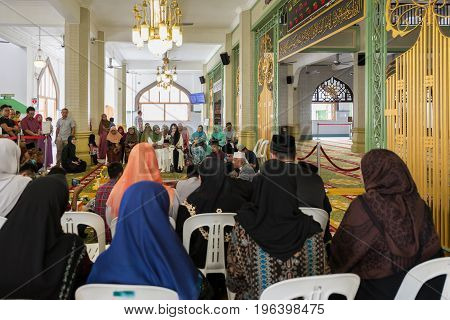 SINGAPORE - MARCH 22 2017: From the back local muslim celebration at Masjid Sultan in Singapore