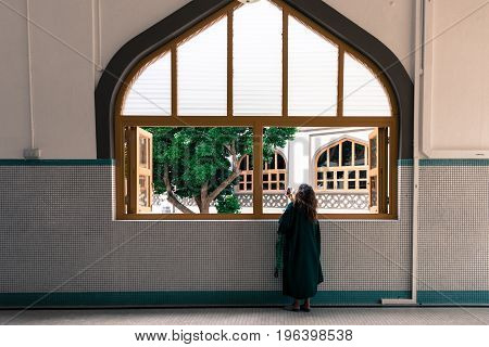 SINGAPORE - MARCH 22 2017: Non muslim tourist taking pictures at Masjid Sultan Mosque in Singapore with proper clothes