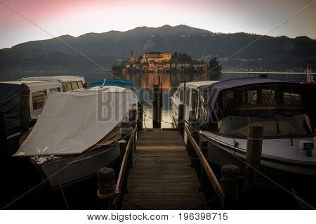 boats on the lake orta at dusk