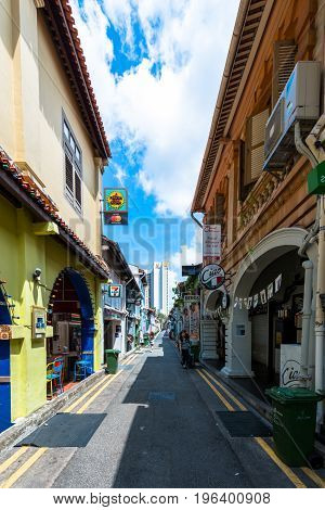 SINGAPORE - MARCH 22 2017: Vertical picture of Haji Lane street in Singapore with restaurants arts and shops.