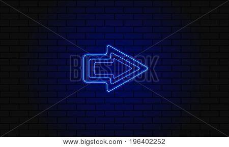 Blue Neon Arrow On A Brick Background