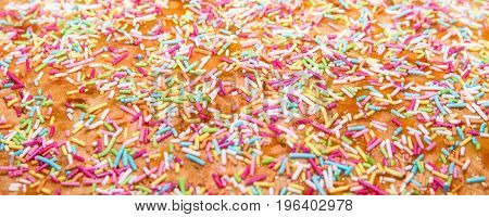 Sugar sprinkle decoration for cake and bekery a lot of sprinkles as a background
