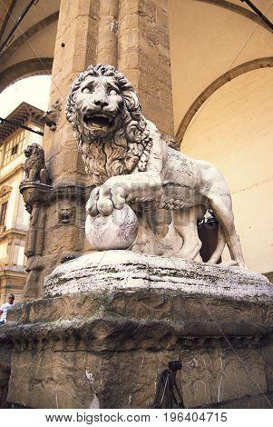 A statue of a lion in the Loggia della Signoria Florence - June 23 2017.