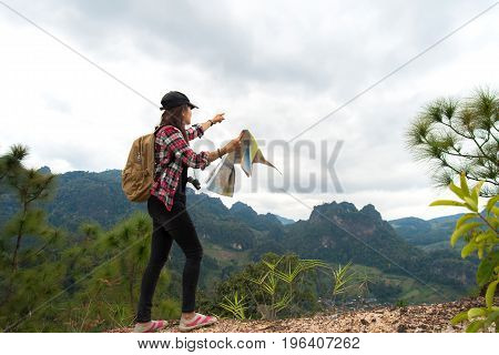 Hiker people woman feeling victorious facing and relax healthy on the mountain Thailand. Travel Concept.