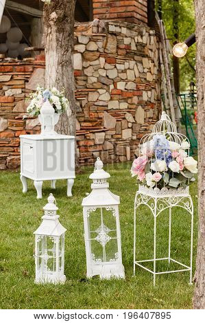 Wedding ceremony decorations bouquets of roses in a park outdoors.