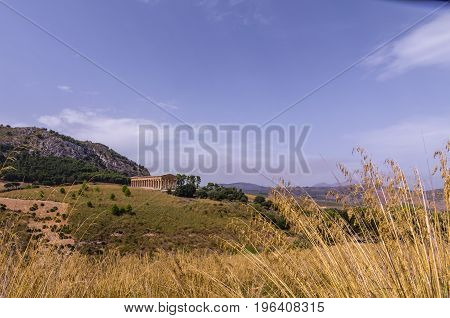 View of the greek temple of segesta and its surroundings in italy sicily