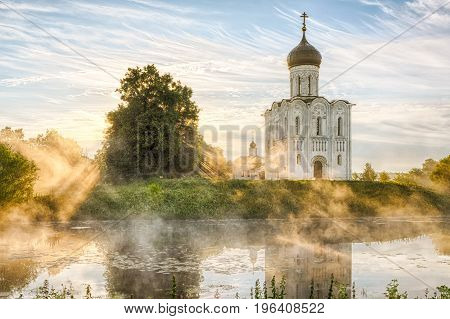 Church of the Intercession on the Nerl with glowing morning fog in Bogolubovo Vladimir oblast Russia