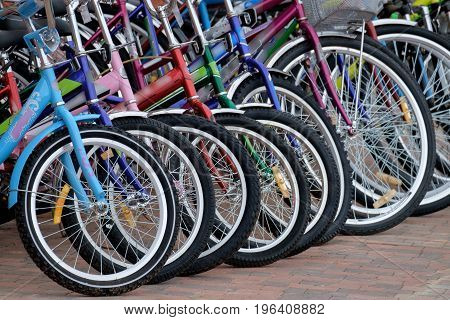 Colorful bikes standing in a row in the Parking lot