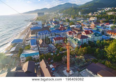 LAZAREVSKOE SOCHI KRASNODAR REGION JULY 5 2017: View of the beach and park of Lazarevskoe city Sochi at sunset