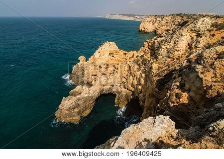 Beautiful Atlantic Ocean View Horizon With Sandy Beach Rocks And Waves At Sunrise Algarve