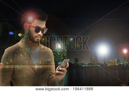 Double exposure Businessmen are using mobile and touch smart phone for Communication and checking