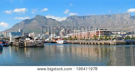 FROM CAPE TOWN, SOUTH AFRICA, THE COLORFUL VICTORIA AND ALFRED WATERFRONT, WITH TABLE MOUNTAIN IN THE BACK GROUND