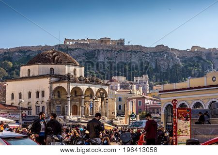 Athens, Greece - March 4 2017: Busy afternoon at monastiraki area with Acropolis and the Parthenon in the background.