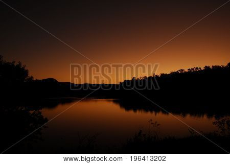 A beautiful gold sunset by the lake.