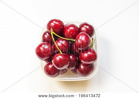 Red Cherries In A Glass Bowl Isolated On White