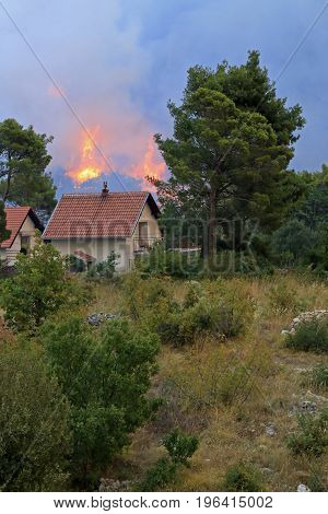 Zrnovnica Split Croatia - July 17 2017: Massive wildfire burning down the forest and villages around city Split