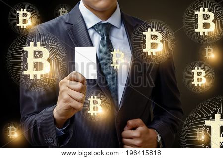 Businessman With A Payment Card And Bitcoins.
