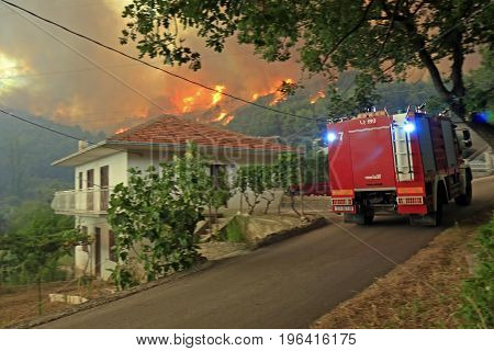 Zrnovnica Split Croatia - July 17 2017: Firefighters coming on scene during massive wildfire burning down the forest and villages around city Split