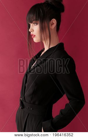 Gorgeous Woman With Dark Hair In Elegant Clothes Posing At Studio