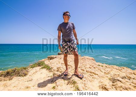 Man On Top Of The Coast Watching The Scene Of The Atlantic Ocean. Summer Vocation Concept