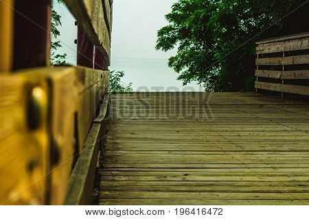 Wooden bridge looking out toward the lake.