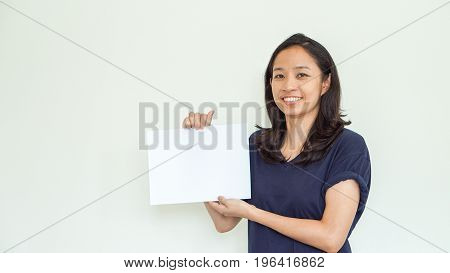 Casual Asian Woman Holding White Sign With Copy Space