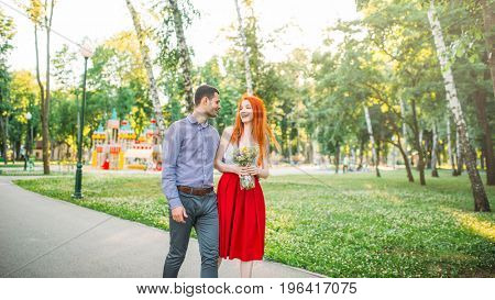 Love couple walk and hugs in summer park
