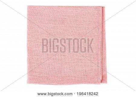 Folded pink textile napkin isolated on white background