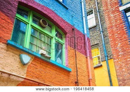 Brightly painted walls and window frames of Neals Yard in London, UK.