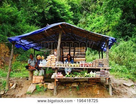 People Selling Fruits On Mountain Road