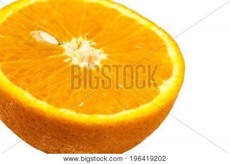 Slice of fresh orange with seed isolated on white background